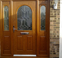 Brown composite-front-door-matching-sidepanels
